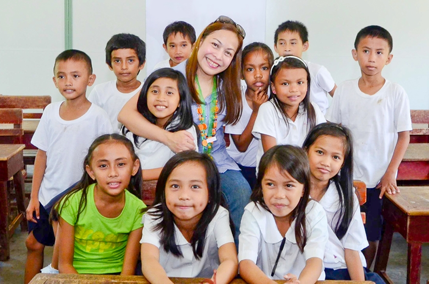 Gabay Guro Chairman Ms. Chaye Revilla with the students
